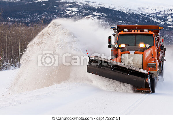 Snow plough clearing road in winter storm blizzard - csp17322151