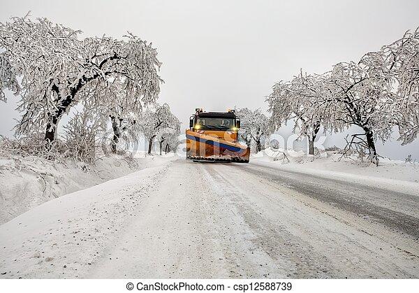 snow plow removes snow - csp12588739