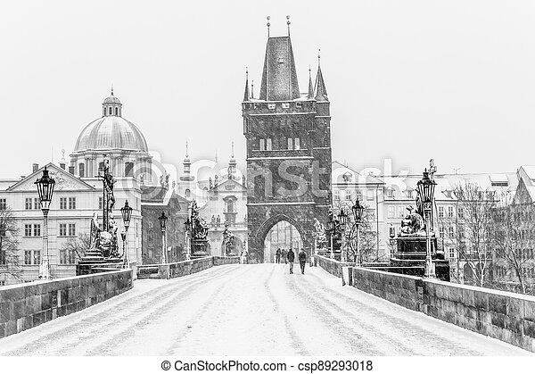 Snow storm on Charles Bridge in Prague - csp89293018