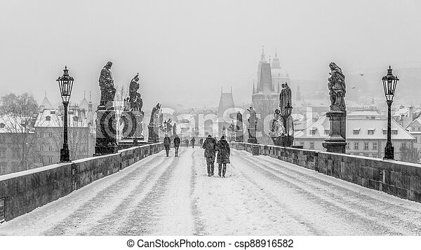 Snow storm on Charles Bridge in Prague - csp88916582