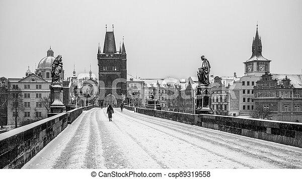 Snow storm on Charles Bridge in Prague - csp89319558