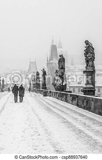Snow storm on Charles Bridge in Prague - csp88937640