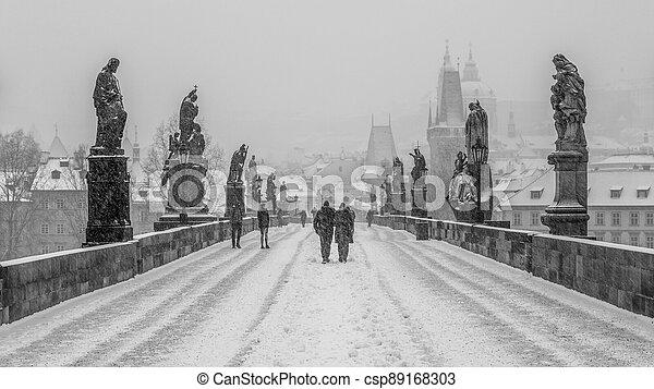 Snow storm on Charles Bridge in Prague - csp89168303