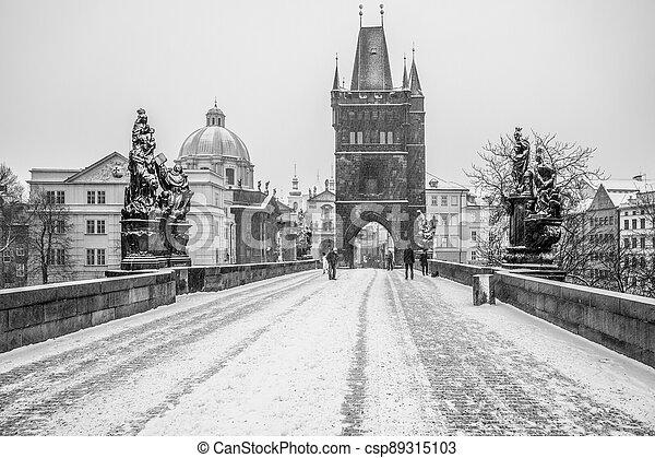 Snow storm on Charles Bridge in Prague - csp89315103