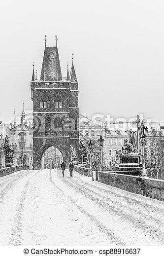 Snow storm on Charles Bridge in Prague - csp88916637