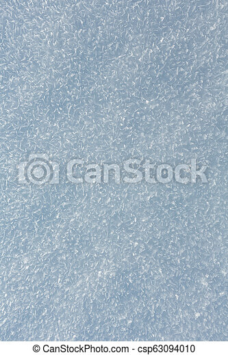 Snow surface with crystalline snowflake - csp63094010