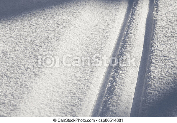 snow texture with cross country skiing traces - csp86514881