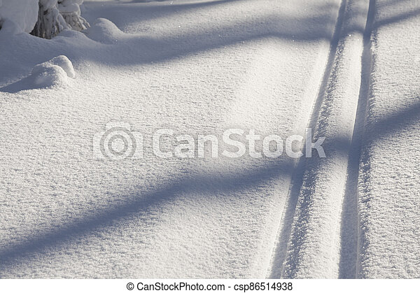 snow texture with cross country skiing traces - csp86514938