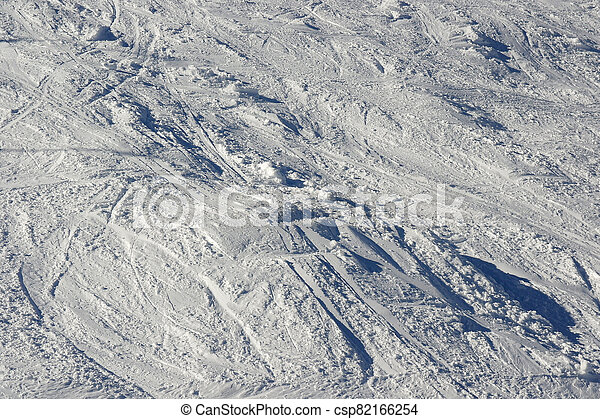 Snow texture with traces of skiing and snowboarding - csp82166254