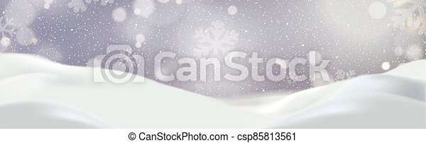 Snowdrifts on a background of blue sky with falling snow - csp85813561