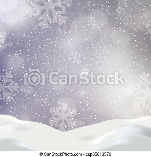 Snowdrifts on a background of blue sky with falling snow - csp85813570