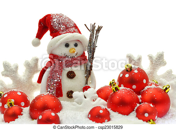 Snowman and Christmas ornaments on snow - csp23015829