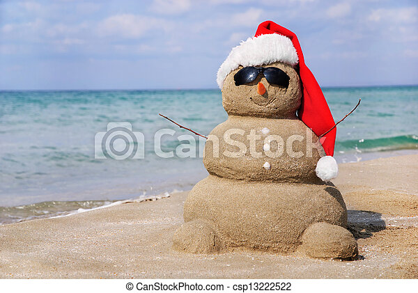 Snowman made out of sand. Holiday concept can be used for New Year and Christmas Cards - csp13222522