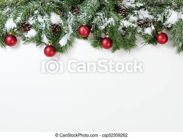 Snowy Christmas Red Ornaments Hanging In Fir Tree Branches