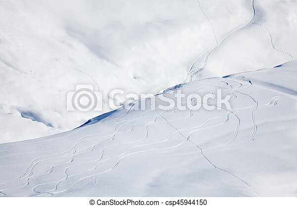 Snowy mountain cowered with curving skiing traces - csp45944150