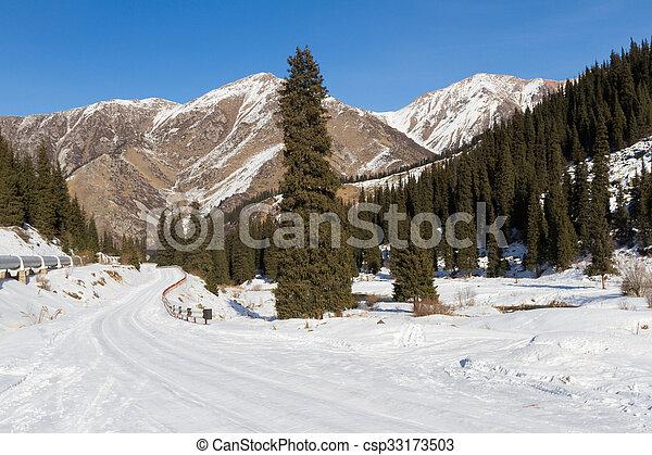 snowy mountain road - csp33173503