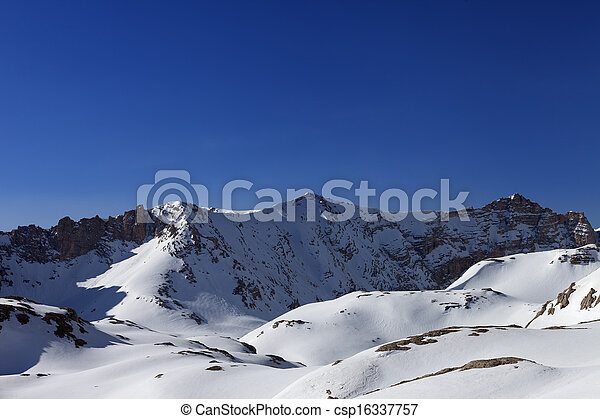Snowy mountains and blue sky in morning - csp16337757