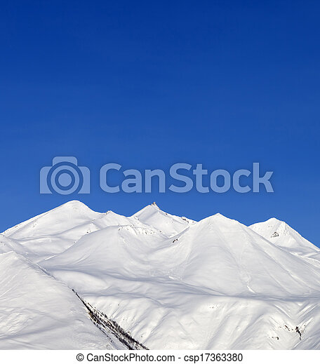 Snowy mountains and blue sky - csp17363380
