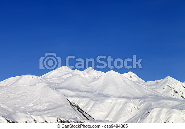 Snowy mountains and blue sky - csp9494365