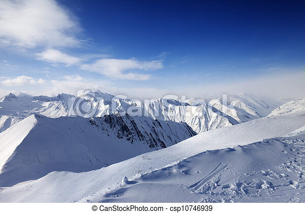 Snowy mountains and blue sky - csp10746939