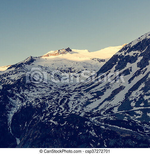 Snowy mountains in the morning. - csp37272701