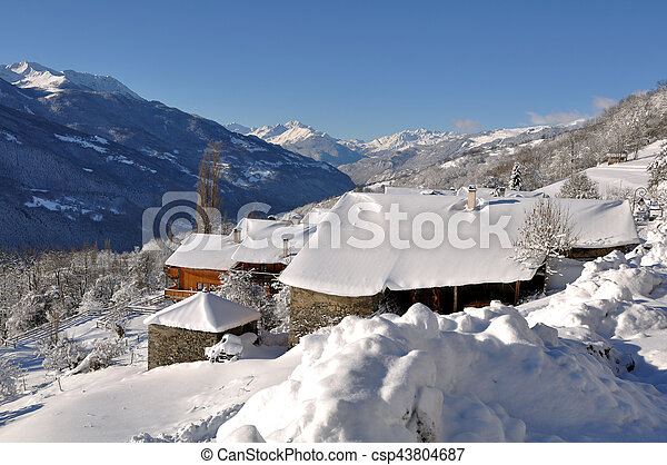 snowy roofs in village - csp43804687