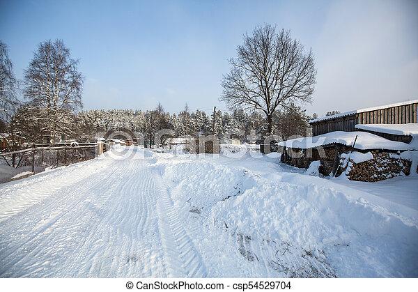 Snowy winter village outdoors in the Karelia Republic, Russia. - csp54529704
