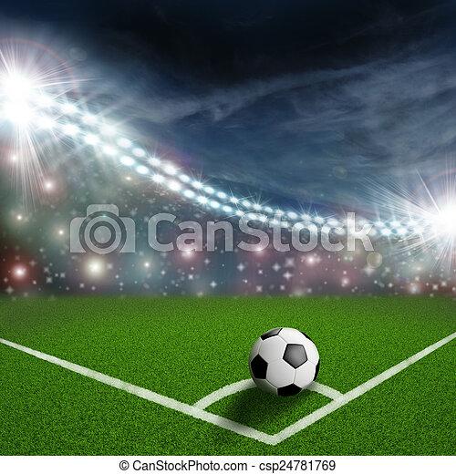 soccer ball on the green field corner - csp24781769