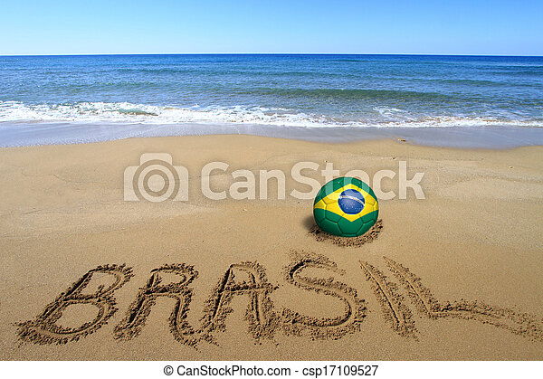 """Soccer ball with Brazilian flag and word """"Brasil"""" written on the beach - csp17109527"""
