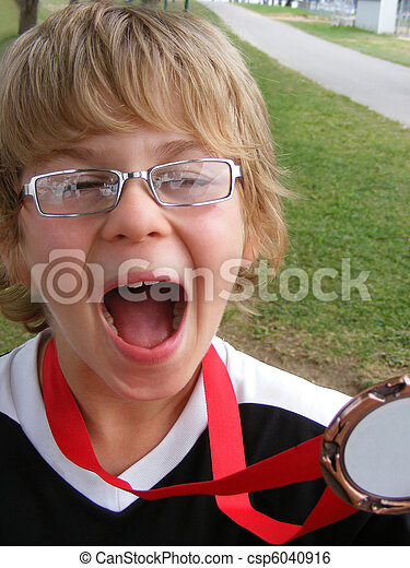Soccer boy yelling for joy w medal - csp6040916