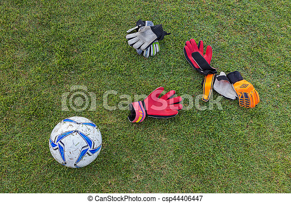Dirty and used soccer gloves and ball on grassy field stock photo soccer gloves and ball on grassy field stock photo voltagebd Images