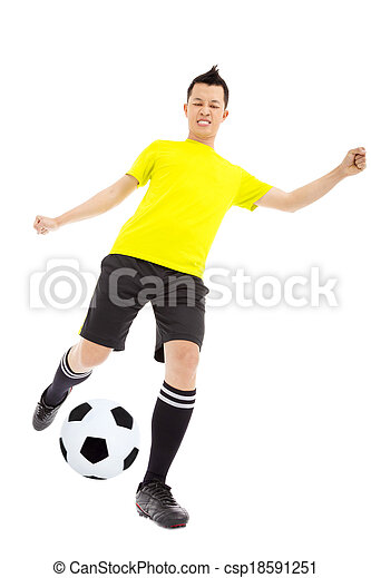 Soccer player kicking ball  - csp18591251