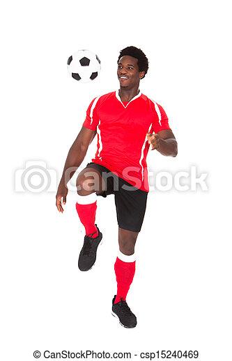 Soccer Player Kicking Football - csp15240469