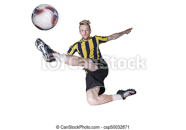 Soccer Player kicking the ball - csp50032871