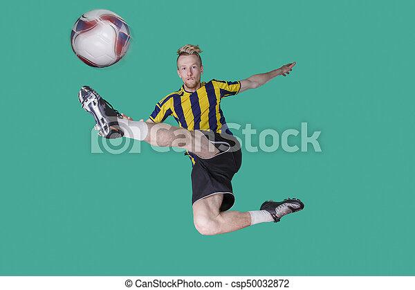 Soccer Player kicking the ball - csp50032872