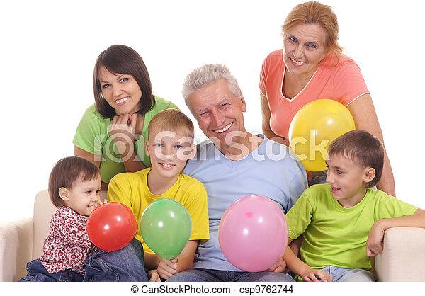 Feliz familia en el sofá - csp9762744