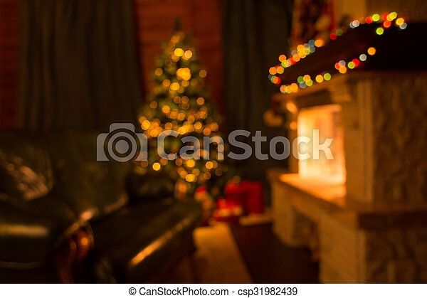 Sofa, fireplace and decorated Christmas tree defocused background - csp31982439