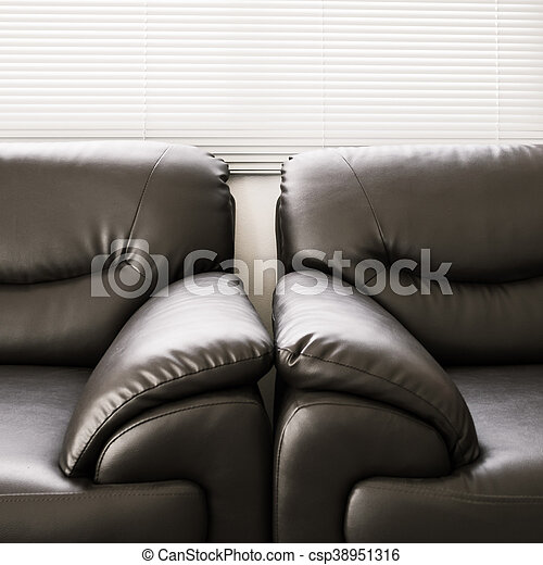 sofa leather black furniture in living room - csp38951316