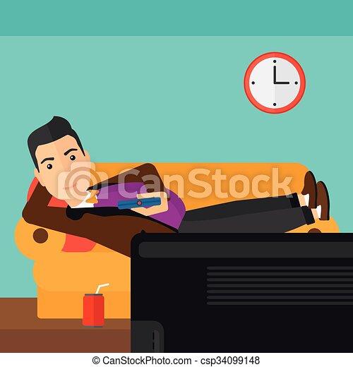 Der Mann liegt auf dem Sofa. - csp34099148
