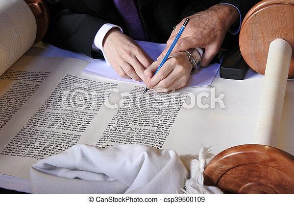 Sofer completing the final letters of sefer Torah - csp39500109