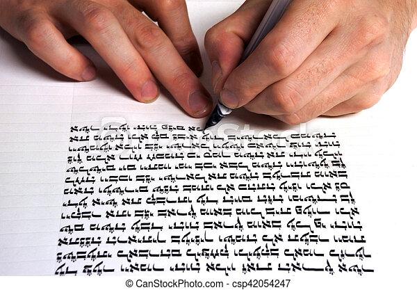 Sofer writes a sefer Torah - csp42054247