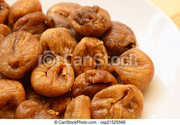 Soft dried figs on a white plate - csp21525566