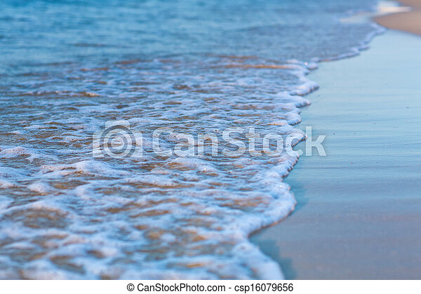 Soft wave of the sea on a sandy beach - csp16079656
