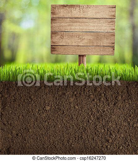 soil cut in garden with wooden sign - csp16247270