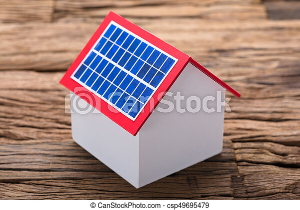 Solar Panel On Model Home At Table - csp49695479