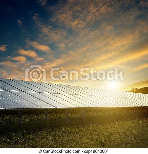 solar panels under sky on sunset - csp19640001