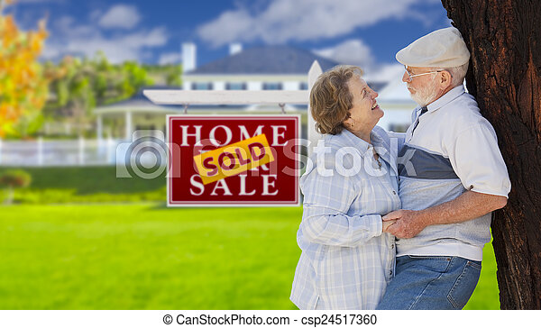 Sold Real Estate Sign with Senior Couple in Front of House - csp24517360