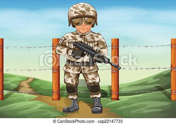 Un soldado sosteniendo un arma - csp22147733