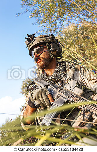 soldier during the military operation at sunset - csp23184428