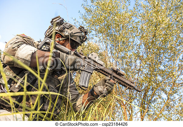 soldier during the military operation in the mountains - csp23184426